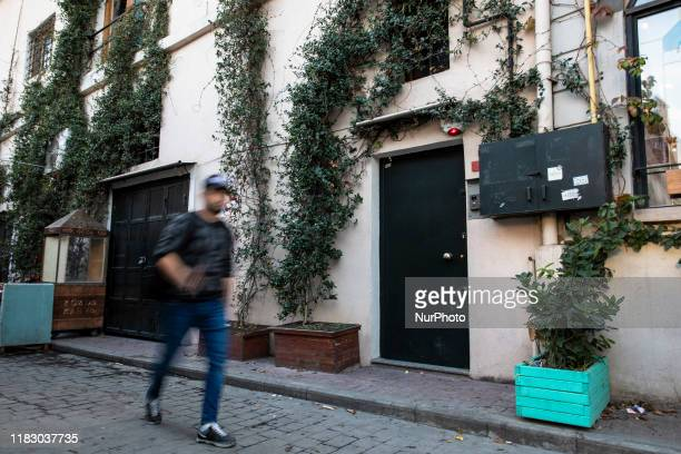 A man walks outside of Former British army officer James Le Mesurier's home office His lifeless body was discovered near his home early morning hour...