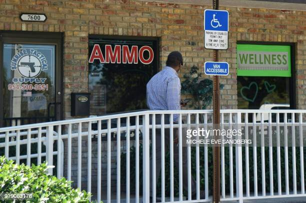 A man walks outside of Sunrise Tactical Supply store in Coral Springs Florida on February 16 2018 where school shooter Nikolas Cruz bought his AR15...