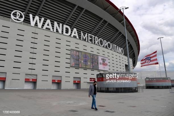 Man walks outside Spanish football club Atletico Madrid's Wanda Metropolitano stadium in Madrid on April 19, 2021. - Plans for a breakaway Super...