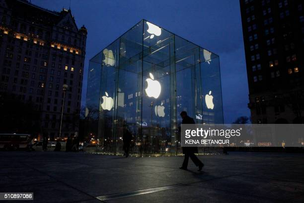 A man walks outside the Apple store on the Fifth Avenue in New York on February 17 2016 Apple's challenge of a court order to unlock an iPhone used...