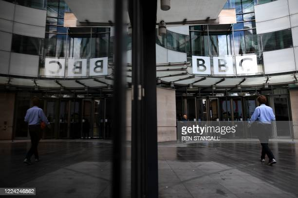 Man walks outside the BBC headquarters in Portland Place, London on July 2, 2020. - The BBC announced on Thursday its intention to cut 450 jobs in...
