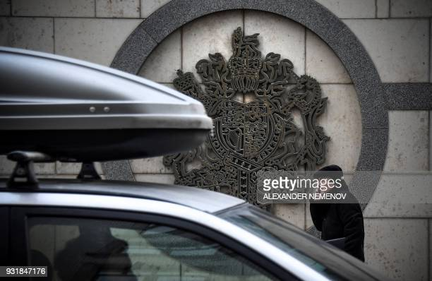 A man walks outside the British embassy building in Moscow on March 14 2018 Britain will expel 23 Russian diplomats over the nerve agent attack on a...