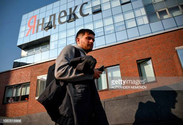 A man walks outside the headquarters of Yandex company Russia's internet search engine in Moscow on October 19 2018 The Russian internet giant Yandex...