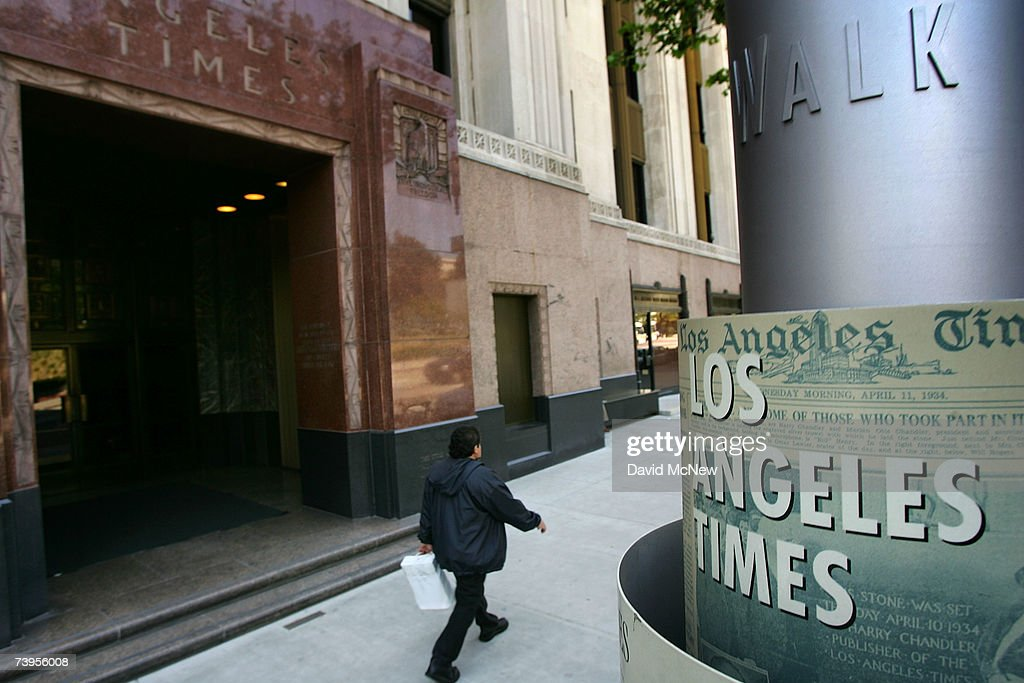 A man walks outside the Los Angeles Times building April 23, 2007 in Los Angeles, California. The Times announced today that it will offer voluntary buyouts in an effort to cut its staff of 2,625 by up to 150. Up to about 70 of those jobs would be in the newsroom, dropping the news staff to about 850. When the Tribune Co. bought the newspaper in 2000, there were 1,200 employed on the news side. Last fall, publisher Jeffrey M. Johnson and then Editor Dean Baquet were forced from the paper for fighting against cuts in the newsroom and arguing that a reduction of reporters and editors would hurt the quality of the paper, a belief contrary to that of Tribune executives.