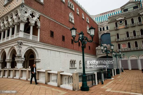 A man walks outside the Venetian casino resort in Macau on May 21 2019