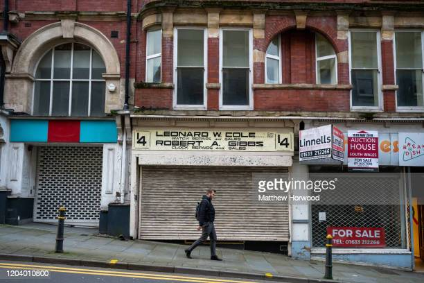 Man walks passed empty shops on Febuary 4, 2018 in Newport, United Kingdom. Last year more than 140,000 high street jobs were lost as store closures...