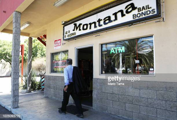 Man walks past a bail bond company located near two jails on August 29, 2018 in Los Angeles, California. California Governor Jerry Brown signed a...