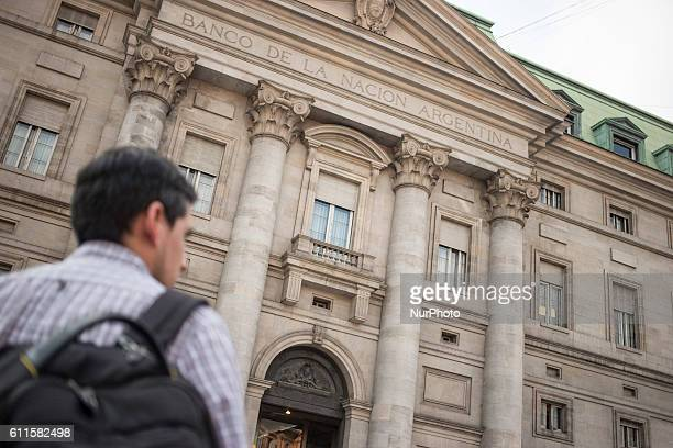A man walks past a Banco de la Nacion Argentina building in Buenos Aires on September 22 2016
