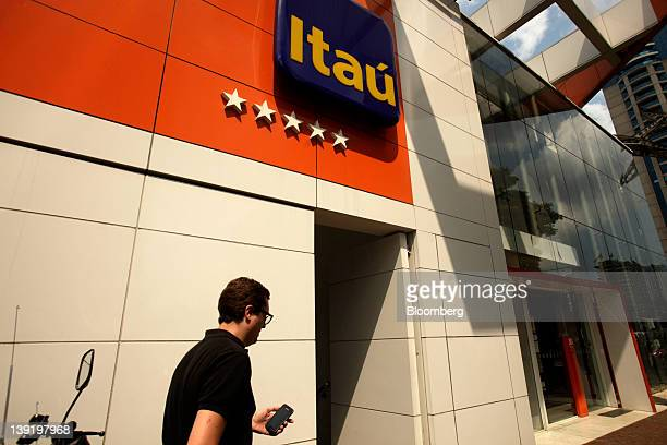 A man walks past a Banco Itau BBA SA branch in Sao Paulo Brazil on Wednesday Feb 15 2012 Brazil's deposit insurance fund the nation's privately owned...