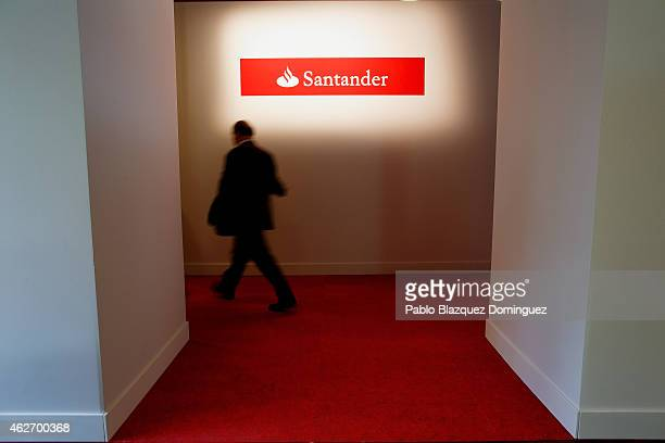A man walks past a Banco Santander's logo before a news conference to announce the 2014 results at the bank's headquarters on February 3 2015 in...