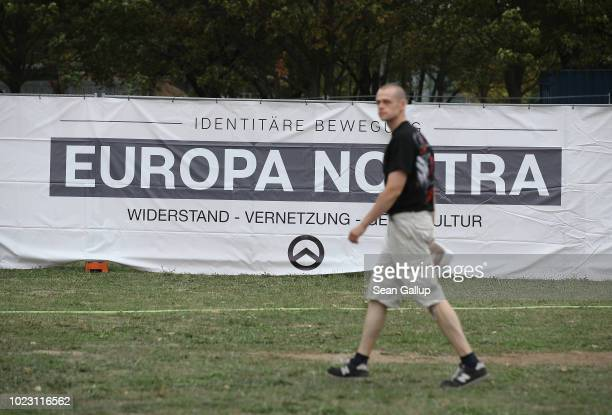 A man walks past a banner at a gathering entitled Europa Nostra and hosted by the Identitarian Movement on August 25 2018 in Dresden Germany The...