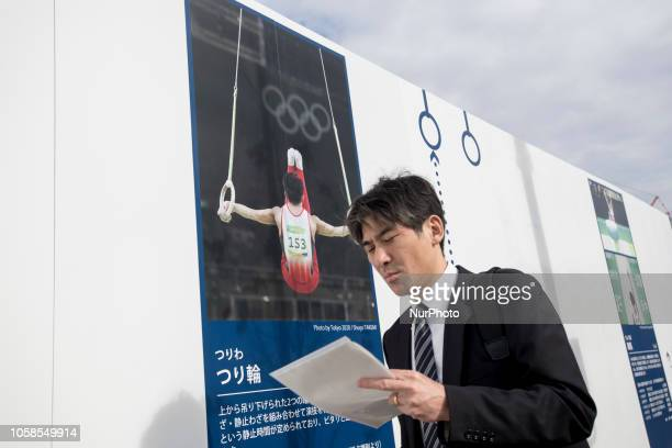 A man walks past a banner map of the venue for Gymnastics of Tokyo Olympics under construction is unveiled to media in Tokyo on November 7 2018 The...