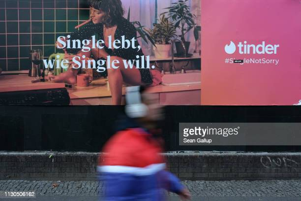 A man walks past a billboard advertisement for the dating app Tinder that reads Single lives as single wants on February 18 2019 in Berlin Germany...