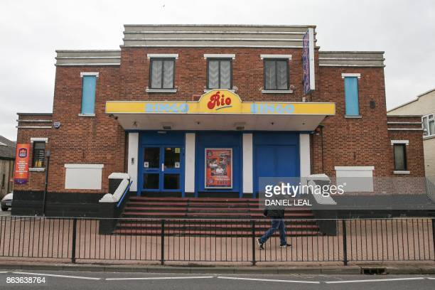 A man walks past a Bingo hall near the seashore on Canvey Island Essex on October 20 2017 A small island community in the Thames Estuary that voted...