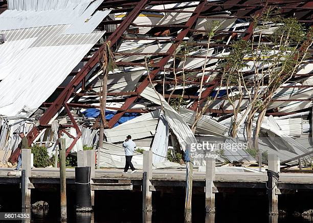 A man walks past a boat storage facility that collapsed as a result of Hurricane Wilma October 26 2005 in Sunny Isles Beach Florida Hurricane Wilma...