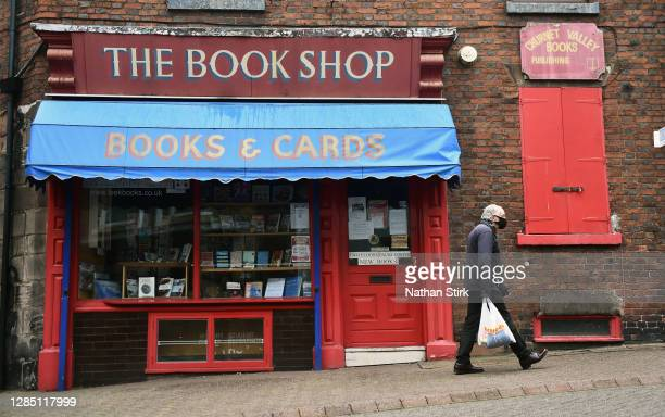 Man walks past a book shop which is closed on November 11, 2020 in Leek, England. The Booksellers Association has called on the government to...