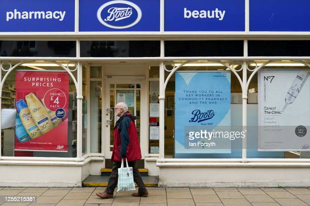 A man walks past a Boots pharmacy on July 09 2020 in York United Kingdom Many UK businesses are announcing job losses due to the effects of the...