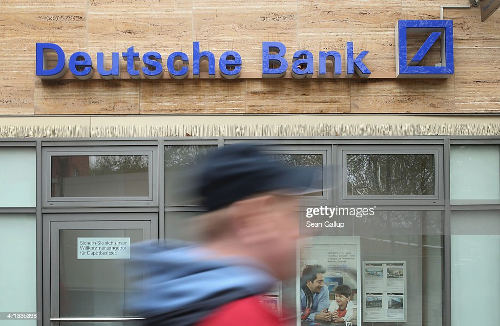 A man walks past a branch of German bank Deutsche Bank on April 27, 2015 in Berlin, Germany. Deutsche Bank announced earlier in the day that it will close 200 of its 700 branches in Germany over the next two years in an effort to save an annual EUR 3.5 billion.