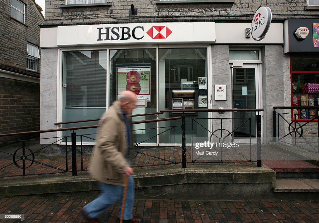 A man walks past a branch of HSBC on March 3, 2008 in Street, United Kingdom. HSBC, the UK's largest bank, has said it has made a 8.7bn GBP loss, after the decline in the US housing market hit the value of its loans. The bank's losses are said to be the biggest write-down of the UK's big five because it has a lot of business and operations in the USA, however its annual profits still rose 10 percent to 12.2bn GBP, up from the year before.