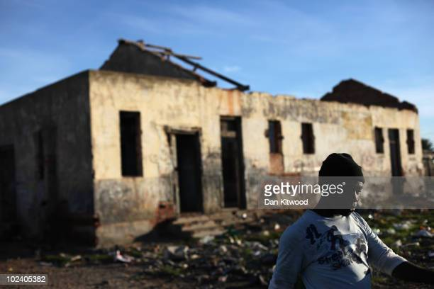 Man walks past a burnt out church in the New Brighton Township on June 24, 2010 in Port Elizabeth, South Africa. The New Brighton Township was...