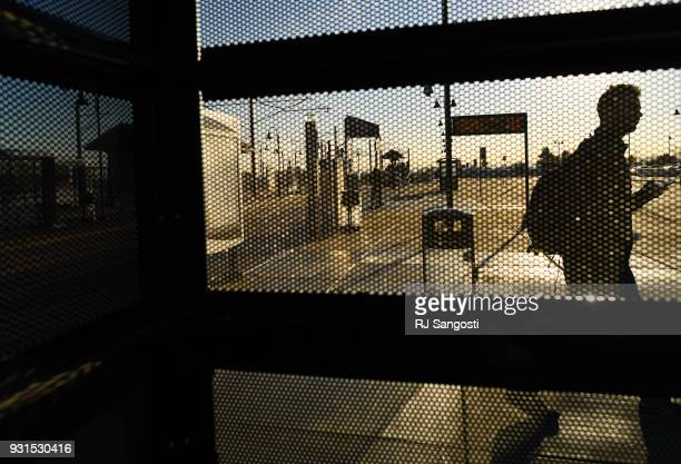 A man walks past a bus shelter way during the morning commute at the Federal Center Light Rail Station on March 13 2018 in Lakewood Colorado A plan...
