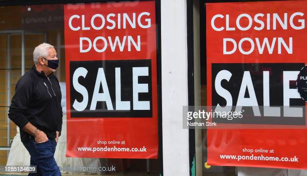 Man walks past a closing down sale sign while shopping in the Market Town of Leek on November 11, 2020 in Leek, England. The United Kingdom will...