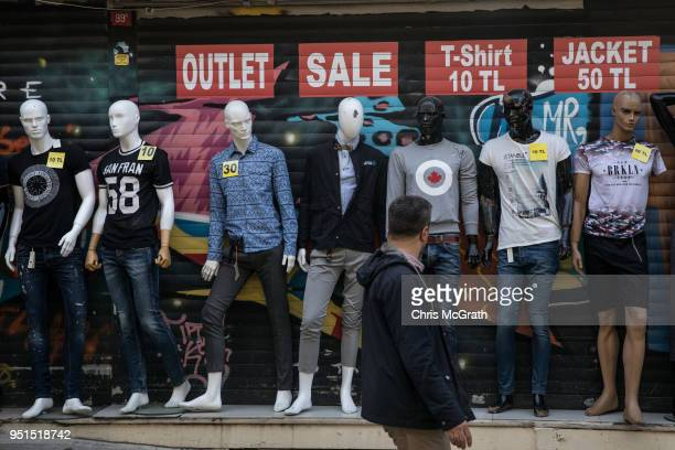A man walks past a clothing store in the tourist area of Galata district on April 26 2018 in Istanbul Turkey As peak tourism season approaches early...