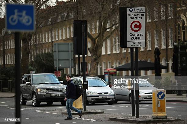 A man walks past a congestion charge sign in Kennington on February 15 2013 in London England The weekday charge was introduced by the then Mayor of...