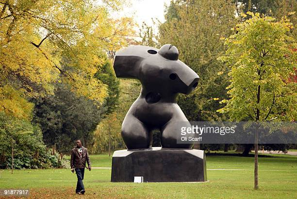 A man walks past a contemporary sculpture on display in the Frieze Art Fair's Sculpture Park in Regents Park on October 14 2009 in London England The...