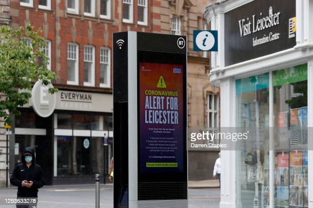 Man walks past a coronavirus alert during lockdown on July 01, 2020 in Leicester, England. Ten per cent of all the recent UKs Covid-19 deaths...