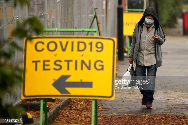 Man walks past a Covid-19 testing site on October 22, 2020 in Sheffield, England. The county of South Yorkshire, which includes the city of Sheffield...