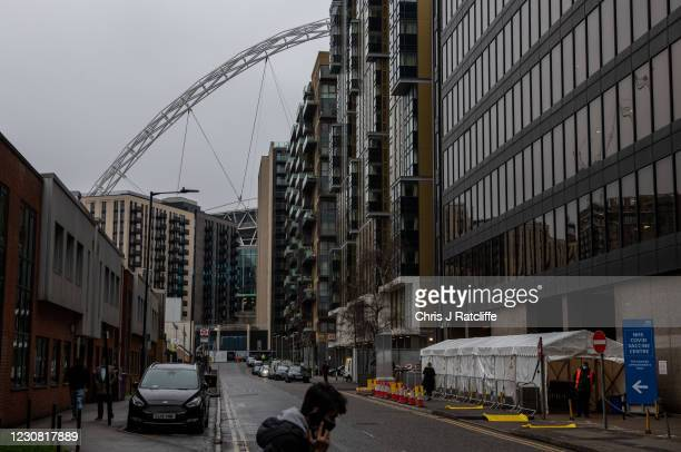 Man walks past a Covid-19 vaccination centre near Wembley Stadium on January 27, 2021 in London, United Kingdom. AstraZenecas chief executive has...