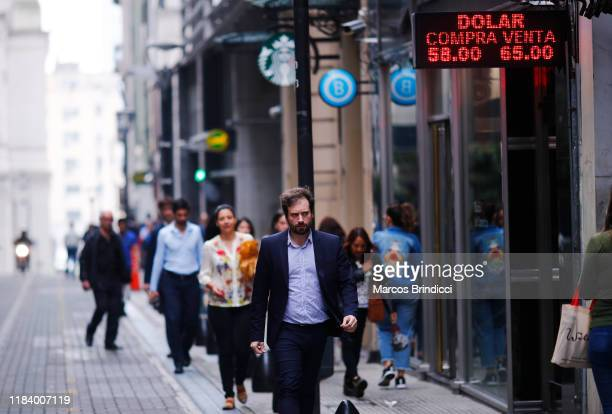 Man walks past a currency exchange house showing updated price of Dollar on October 28 2019 in Buenos Aires Argentina National Central Bank...