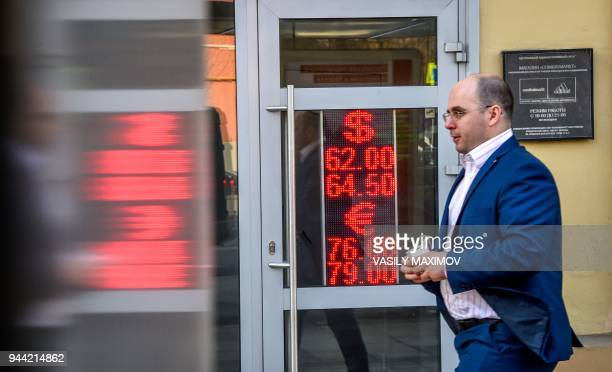 A man walks past a currency exchange office in Moscow on April 10 2018 Russia's central bank on Tuesday sought to reassure the public after new US...