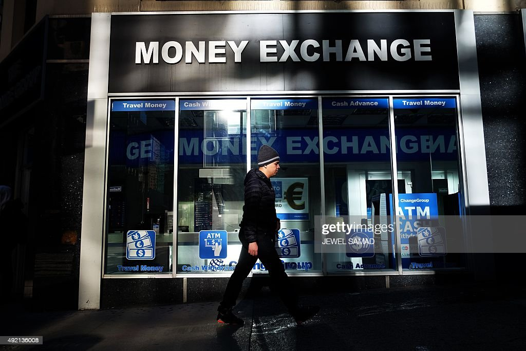 A man walks past a currency exchange office in new york on october