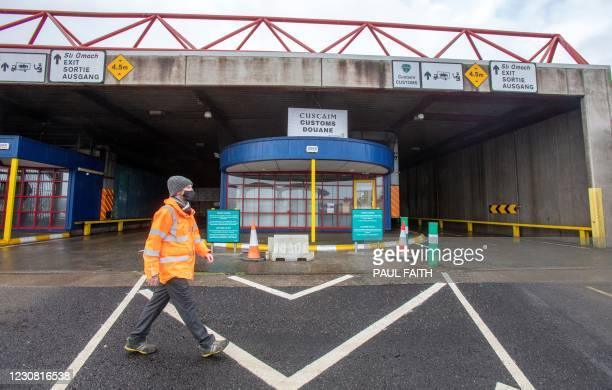 Man walks past a Customs checkpoint at the port of Rosslare Harbour in Rosslare, southeast Ireland on January 27, 2021. - Ireland has ramped up...