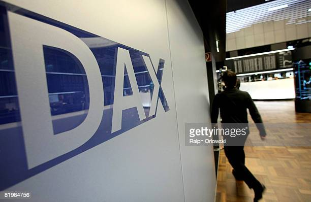 A man walks past a Dax logo on the trading floor of Frankfurt stock exchange during a trading session on July 17 2008 in Frankfurt Germany Today the...