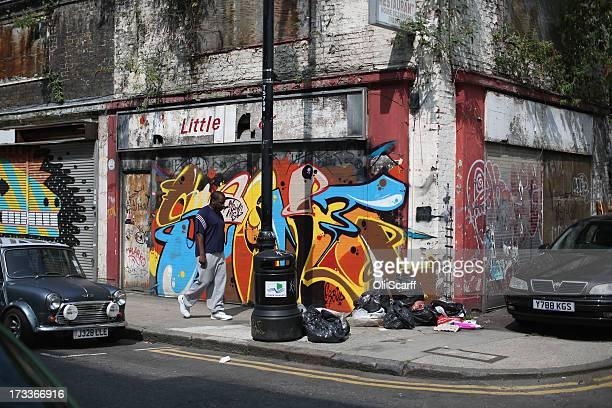 A man walks past a derelict shop near Petticoat Lane Market on July 12 2013 in London England Petticoat Lane Market is a historic clothing market in...