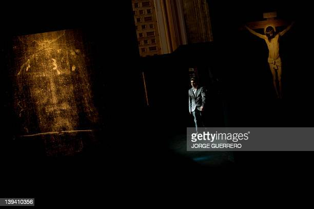A man walks past a facsimile of 'The Shroud of Turin' at the Cathedral of Malaga on February 20 2012 AFP PHOTO/ JORGE GUERRERO