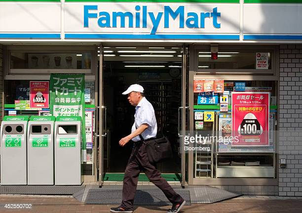 A man walks past a FamilyMart Co convenience store in Tokyo Japan on Wednesday July 23 2014 Japan suspended food imports from Shanghai Husi Food Co a...