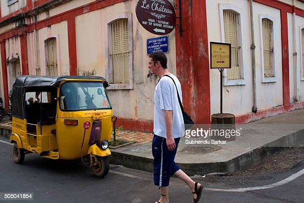 A man walks past a French colonial building in Puducherry Puducherry formerly known as Pondicherry is a Union Territory of India In 1674 Pondicherry...