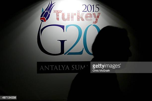 A man walks past a G20 Summit sign ahead of the start of the G20 Turkey Leaders Summit on November 14 2015 in Antalya Turkey World leaders delegates...