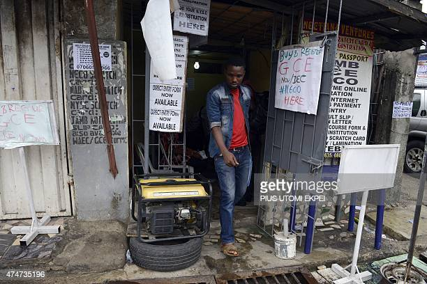 A man walks past a generator that supplies electricity to the business centre in Lagos on May 23 2015 Nigerian homes and businesses are forced to use...