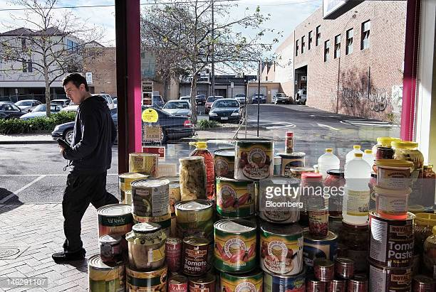 A man walks past a Greek deli in Oakleigh a suburb of Melbourne Australia on Tuesday June 12 2012 Armed with patriotism and the bestperforming...