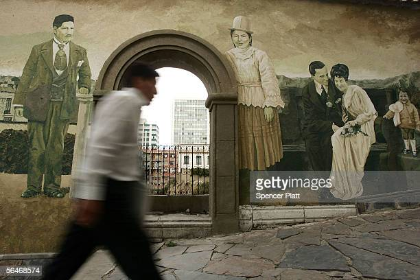 A man walks past a historic mural December 19 2005 in downtown La Paz Bolivia A day after the historic election of Evo Morales as president of...