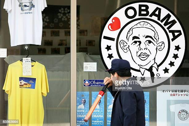 A man walks past a I Love Obama poster in support of the Democratic presidential candidate US Sen Barack Obama on November 5 2008 in Obama Fukui...