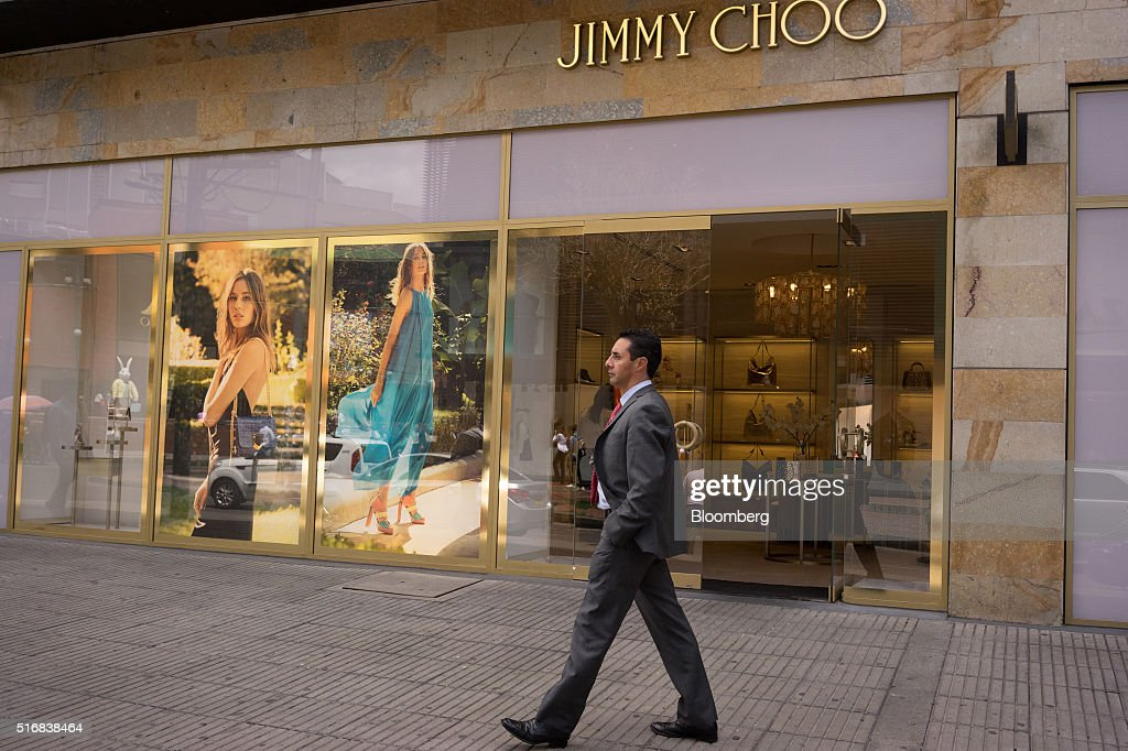 A man walks past a Jimmy Choo store in Bogota, Colombia, on Wednesday, March 16, 2016. Colombia's central bank raised its benchmark interest rate for a seventh straight month as the inflation outlook continued to worsen and economic growth unexpectedly accelerated. Photographer: Mariana Greif Etchebehere/Bloomberg via Getty Images