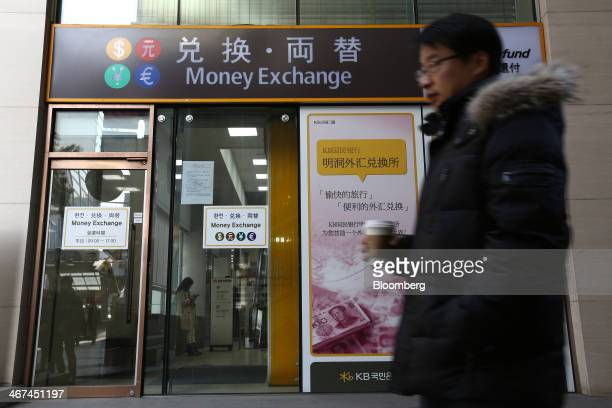 A man walks past a Kookmin Bank branch at the KB Financial Group Inc headquarters in Seoul South Korea on Thursday Feb 6 2014 KB Financial is...