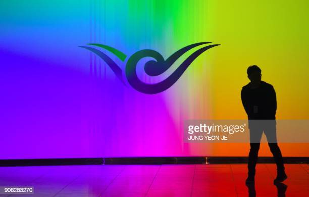 A man walks past a logo of Incheon International Airport at its Terminal 2 west of Seoul on January 18 2018 Incheon airport South Korea's top gateway...