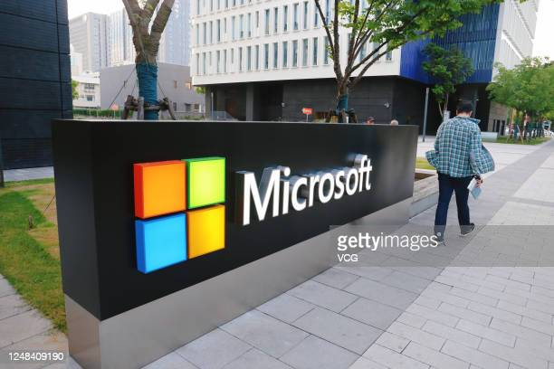 Man walks past a logo of Microsoft outside an office building at Shanghai Caohejing Hi-Tech Park on June 6, 2020 in Shanghai, China.